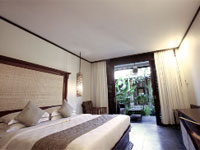 deluxe room at  kuta sea view cottage